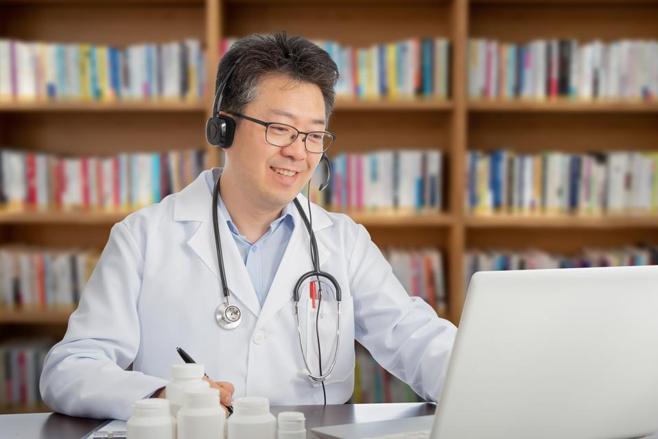Doctor remotely consulting with a patient