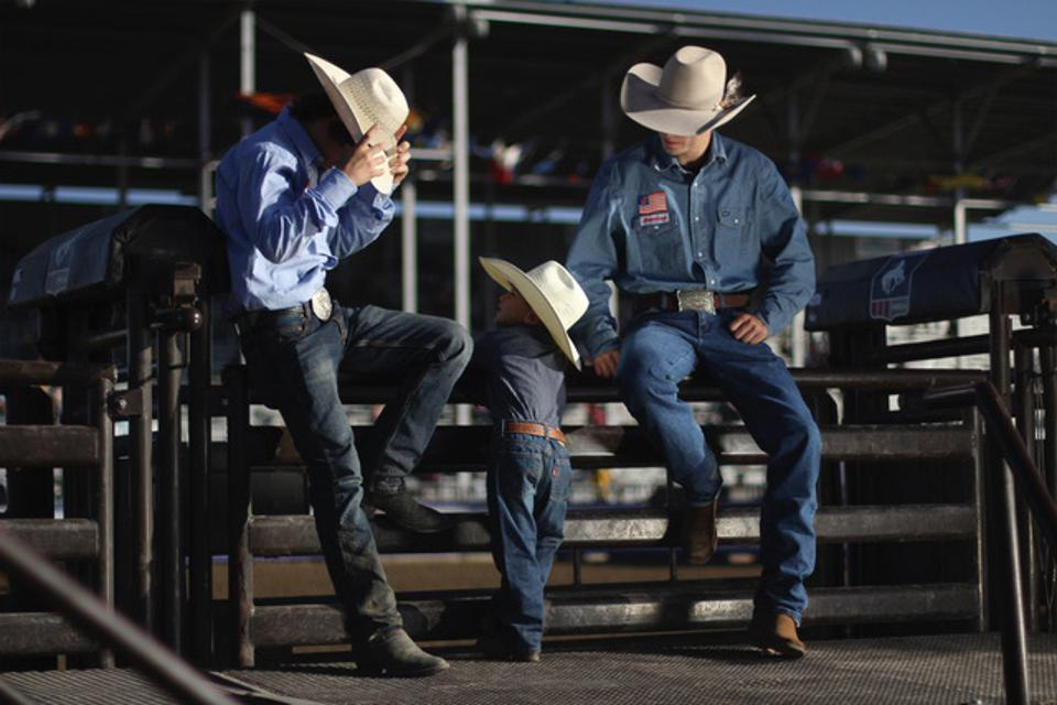 JC Mortenson getting ready to ride in the short round at the National High School Rodeo Association Finals in Rock Springs, Wyoming. His brothers, Jaxton and Juke, are helping him.