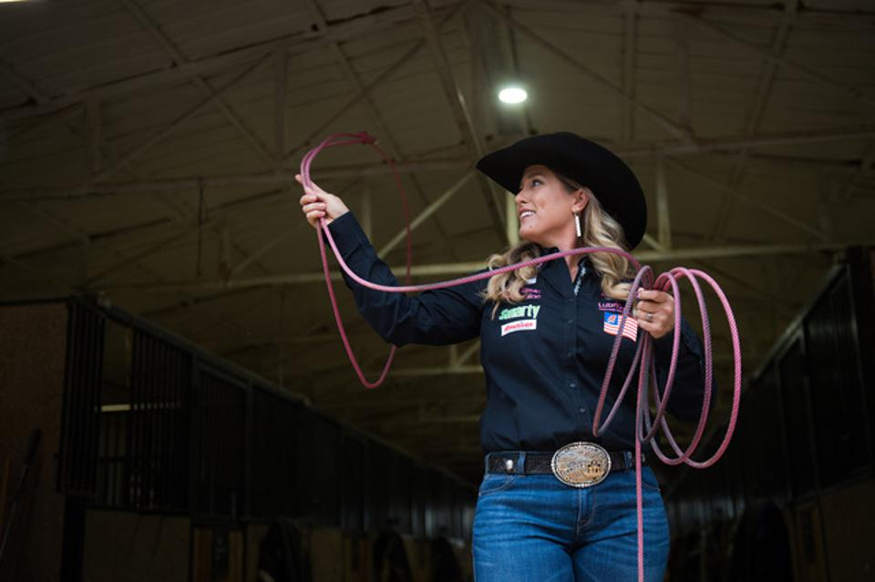Champion All Around Cowgirl and Breakaway Roper, Jackie Crawford practicing her swing.