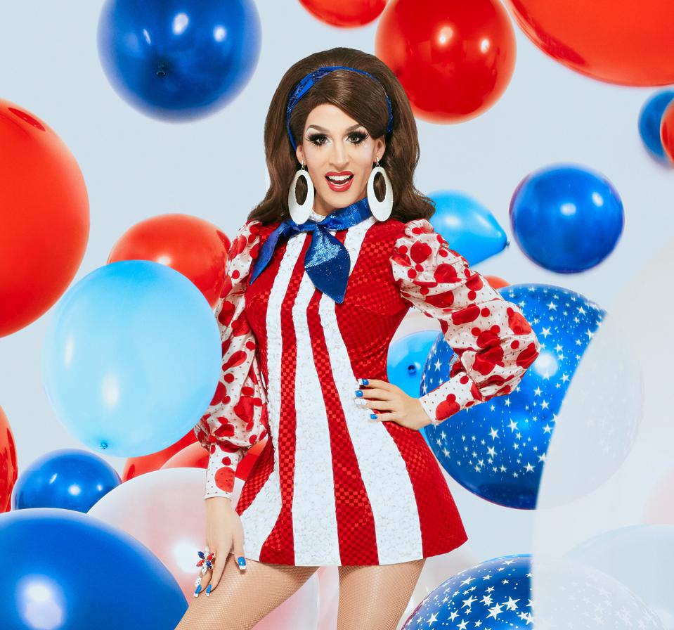 drag queen in red white and blue with balloons