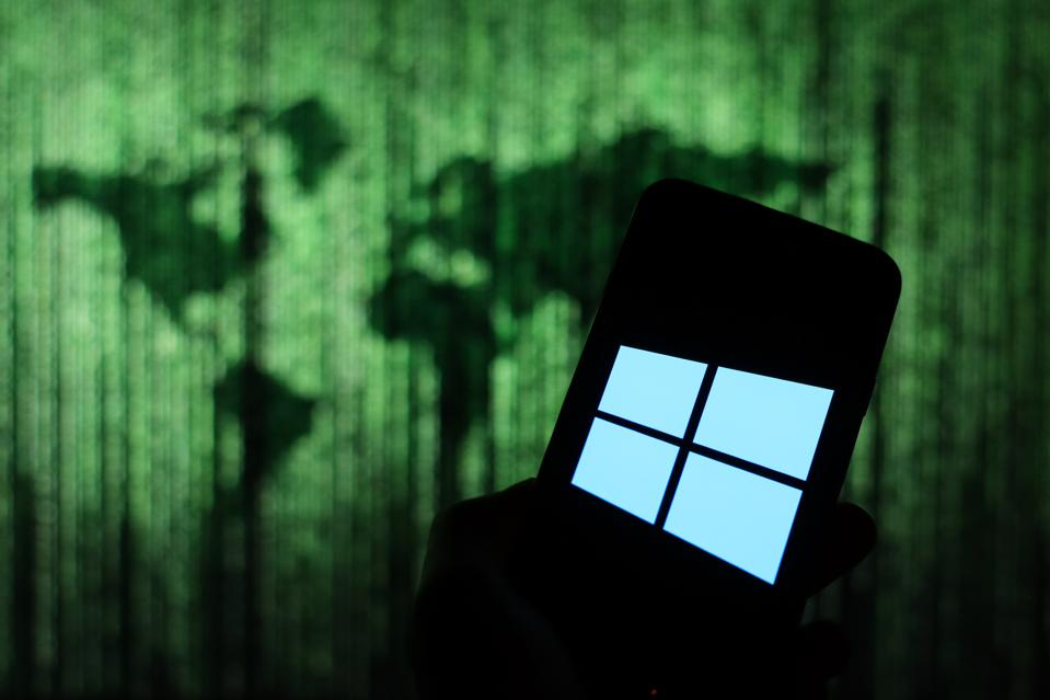 In this photo illustration a Microsoft Windows 10 logo seen...