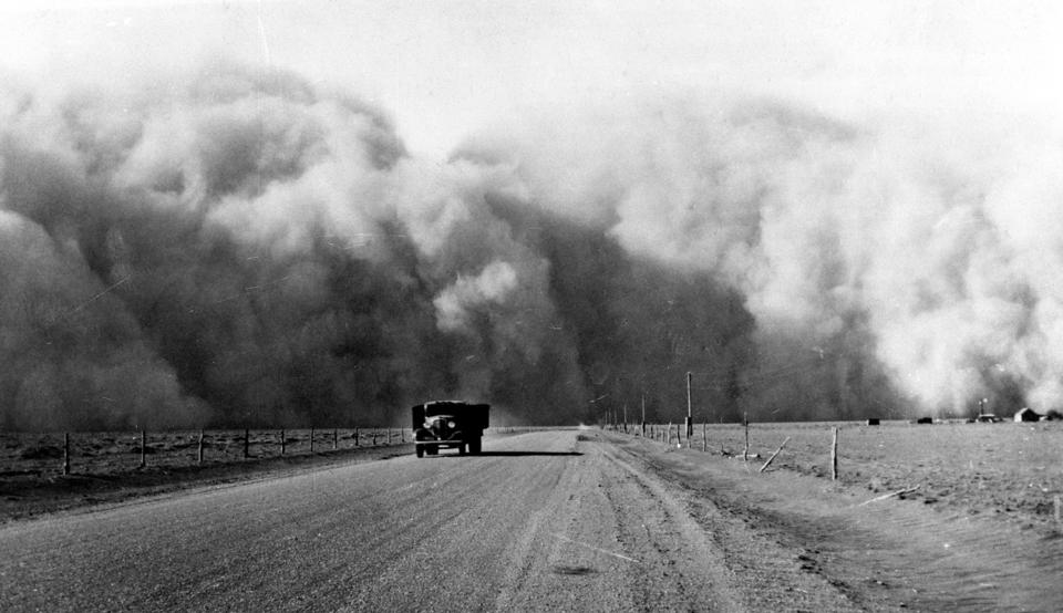 A huge dust cloud appears behind a truck on highway 59 in Colorado, in May 1936.