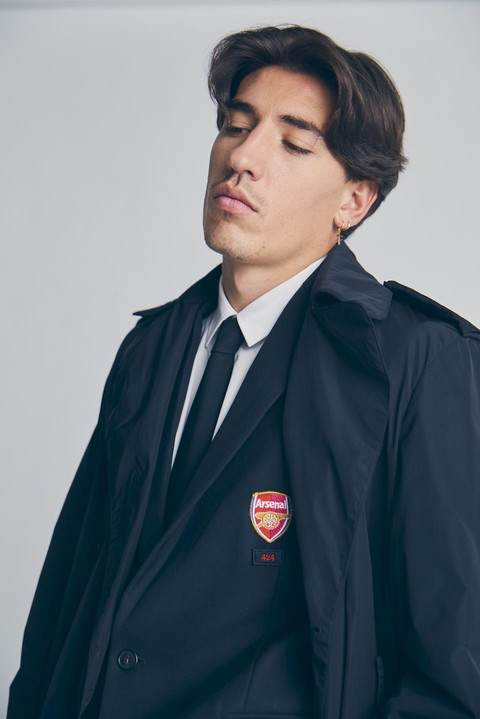 Image of Arsenal player Hector Bellerin in suit.
