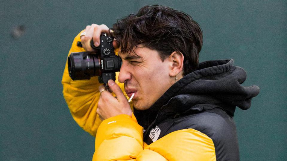Arsenal player Hector Bellerin taking a photo.