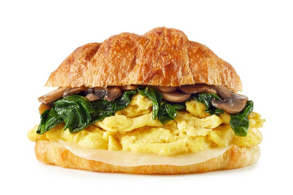 Plant-based JUST Egg is the base for items like this egg and spinach on a croissant.