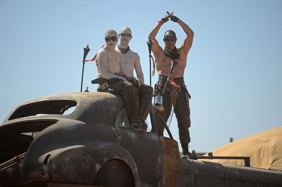 Attendees at a festival in the Mojave desert dressed as characters from Mad Max: Fury Road