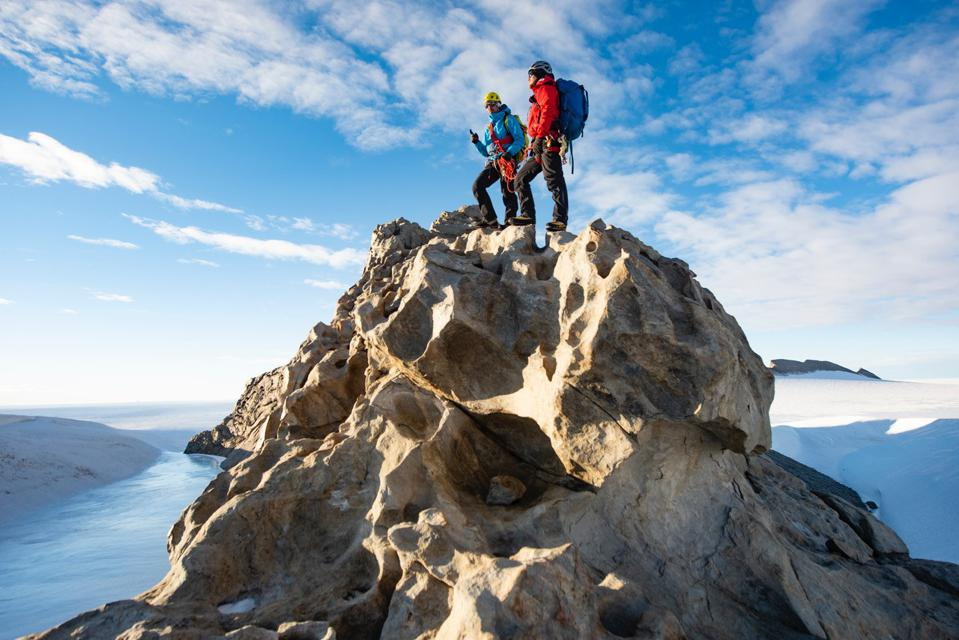 hikers on a mountaintop in Antarctica