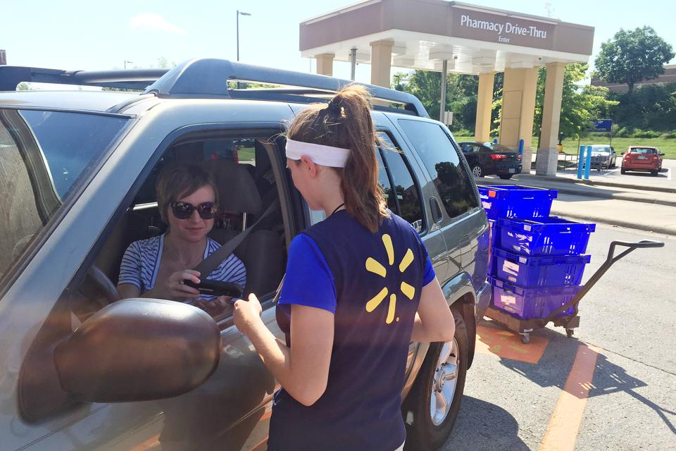 Manual fulfillment of online orders. Ashley Green, 31, talks to a Walmart personal shopper