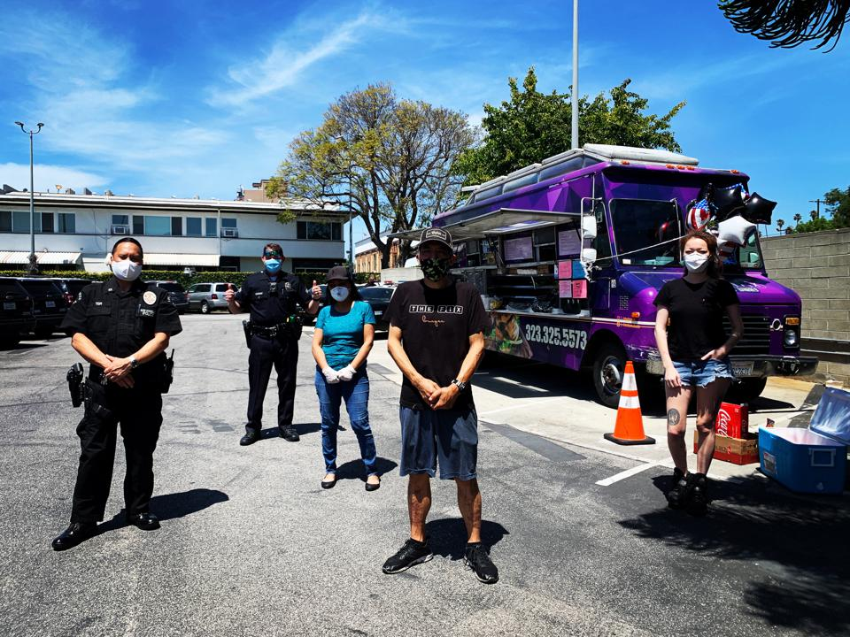 Food truck workers stand 6 feet apart