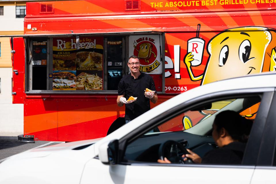 Richeeze dropping off grilled cheese to customers in cars