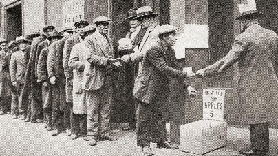 A line of unemployed men buy apples for 5 cents during the Great Depression of America