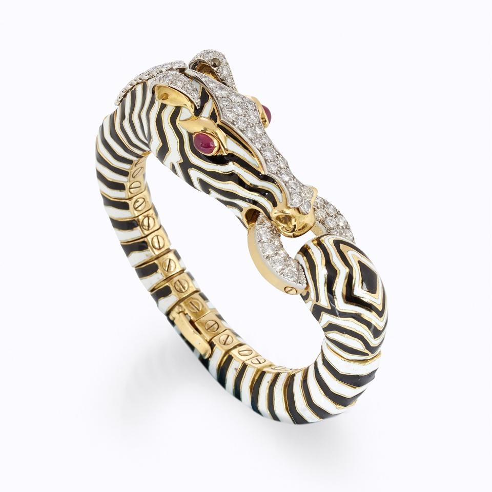 An enamel, diamond, ruby and 18k gold zebra bangle by David Webb