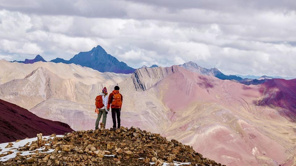 The author and a friend hiking the Ausangate trek in Peru