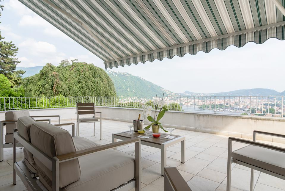 The large terrace has wide lake views