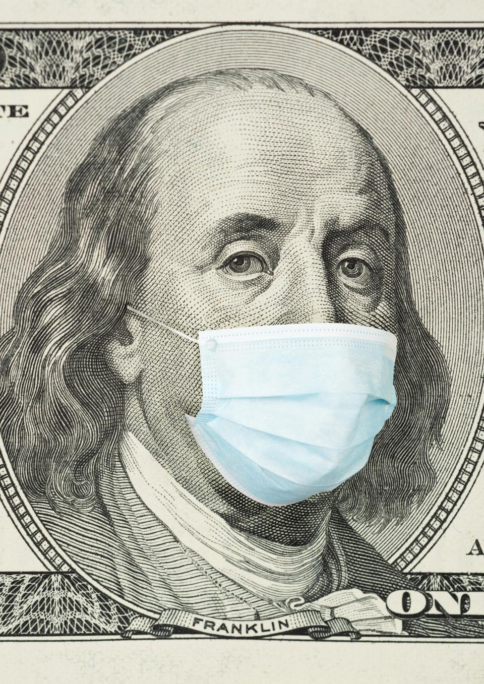 100 dollar banknote with medical mask