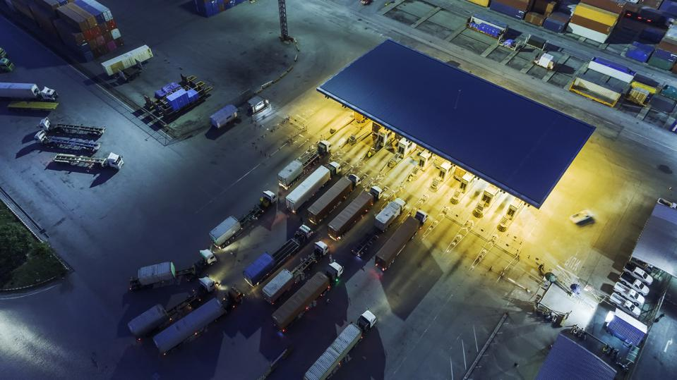 Aerial view container truck waiting at check point