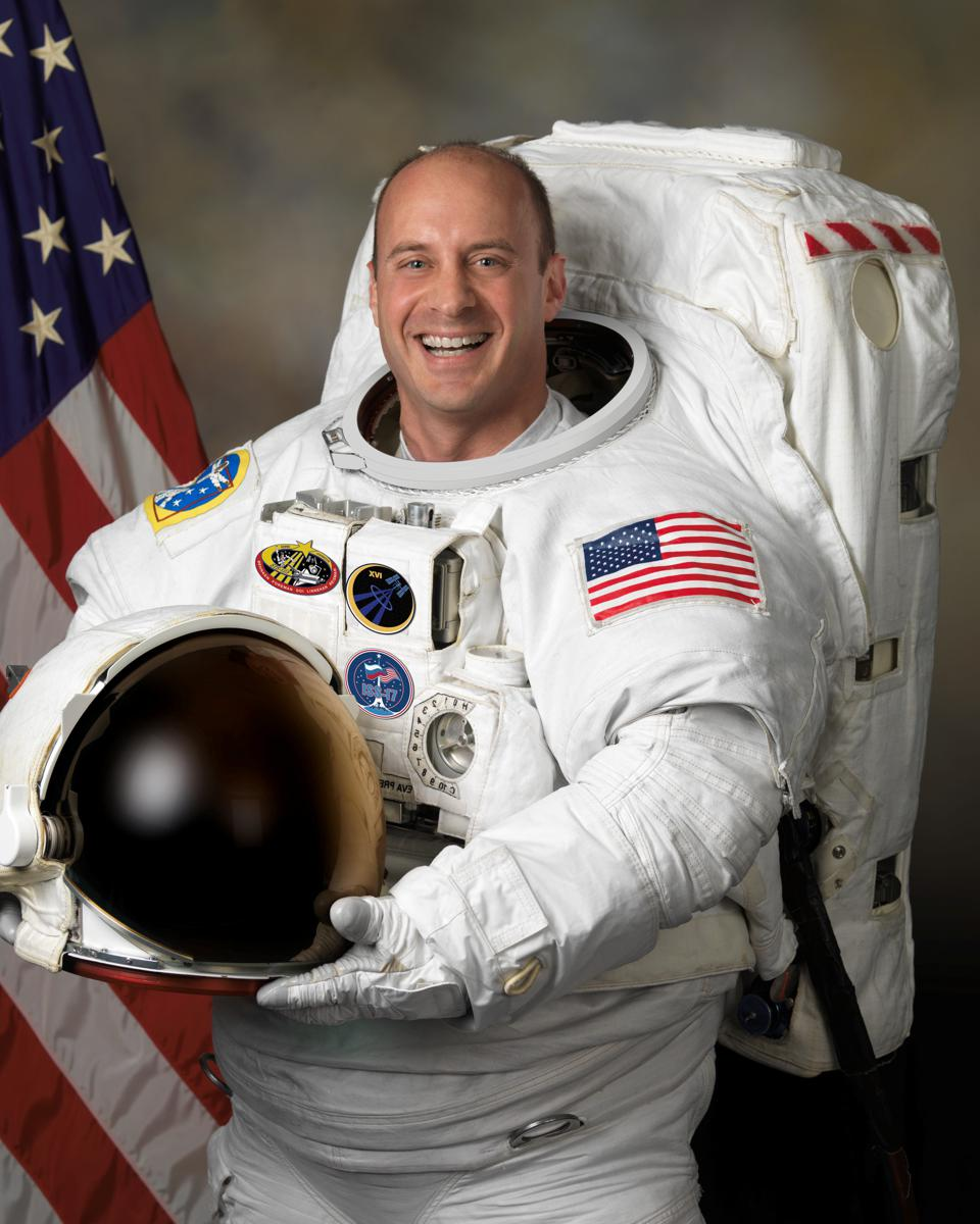 Dr Garrett Reisman, astronaut in white space suit