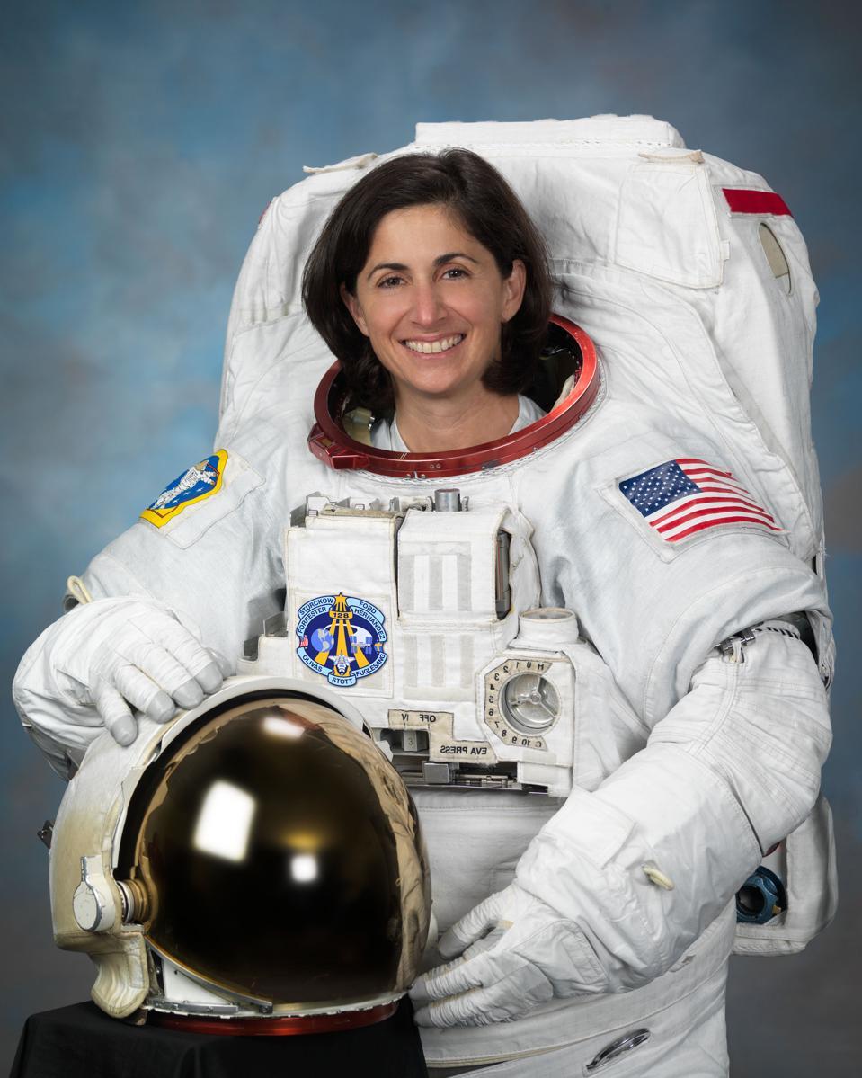 Nicole Stott, astronaut in white space suit