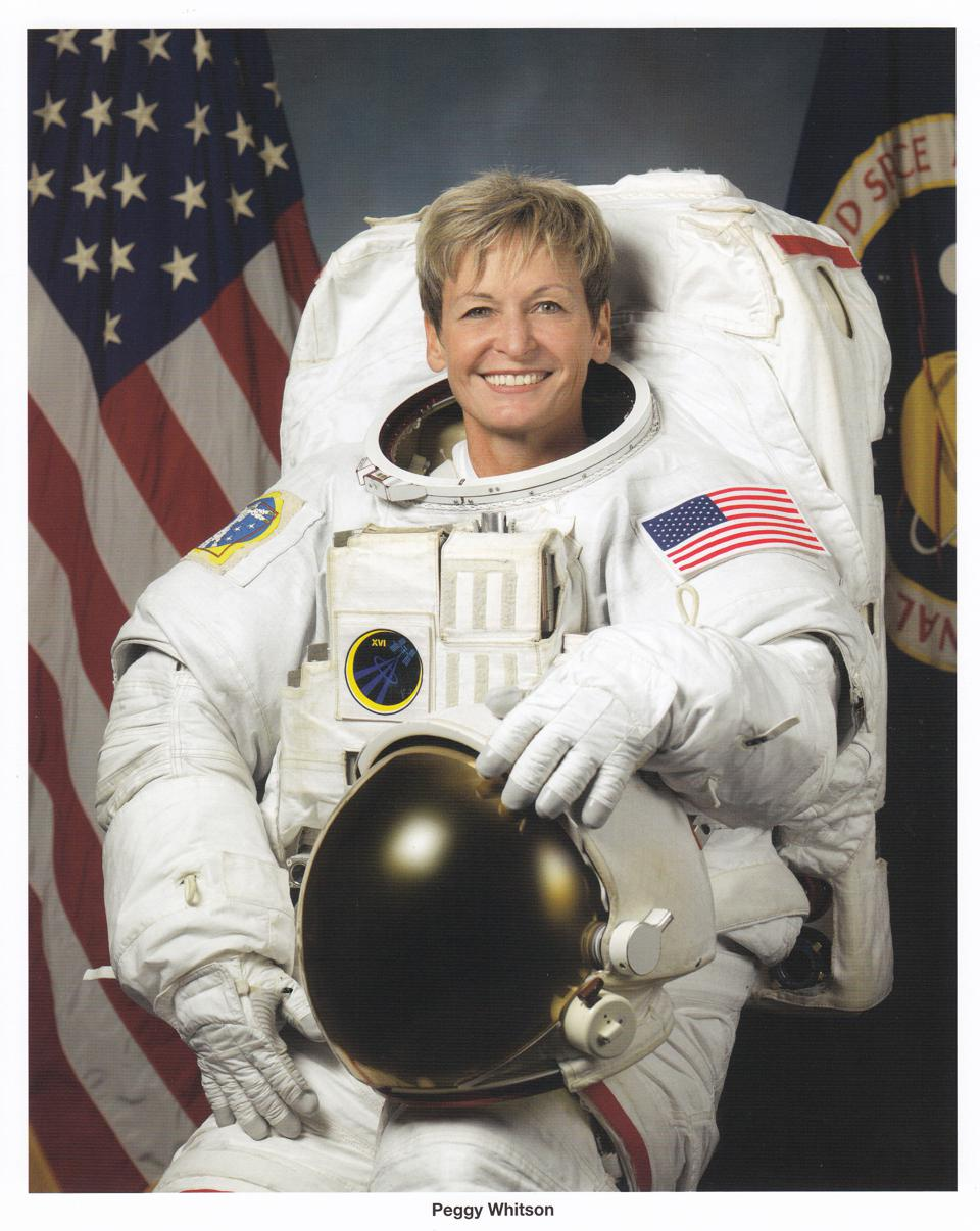 Dr Peggy Whitson, astronaut in white space suit