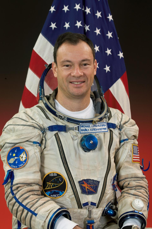 Michael Lopez-Alegria in white space suit