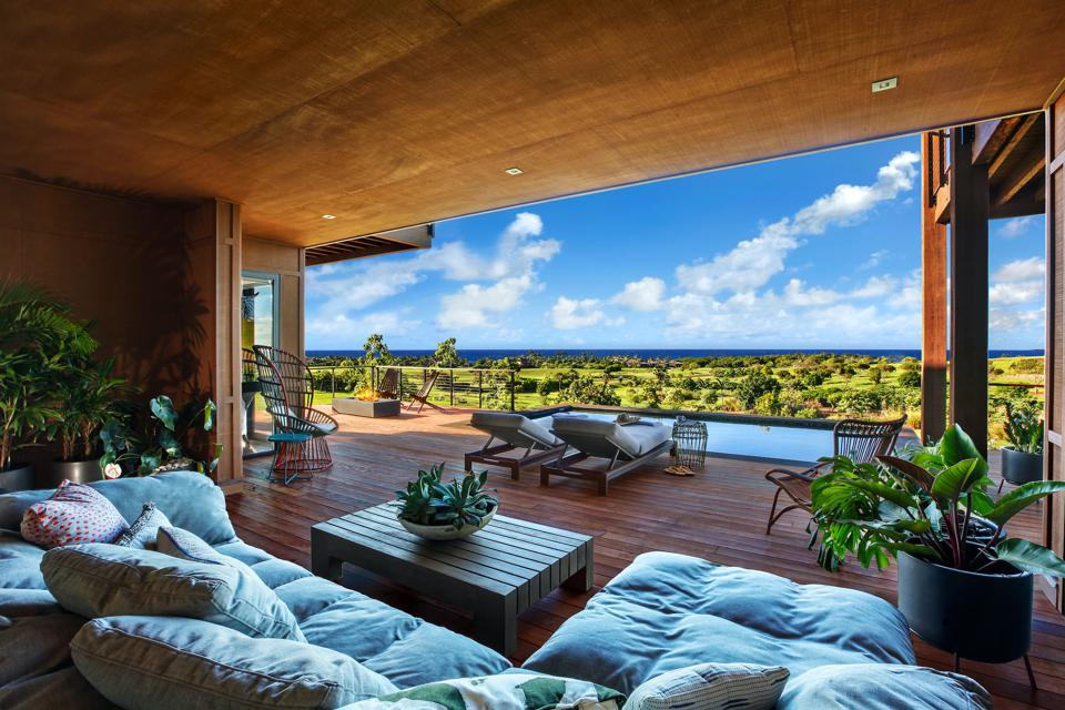 The lower level lanai (seen above) features a swimming pool, spa and a wet bar.
