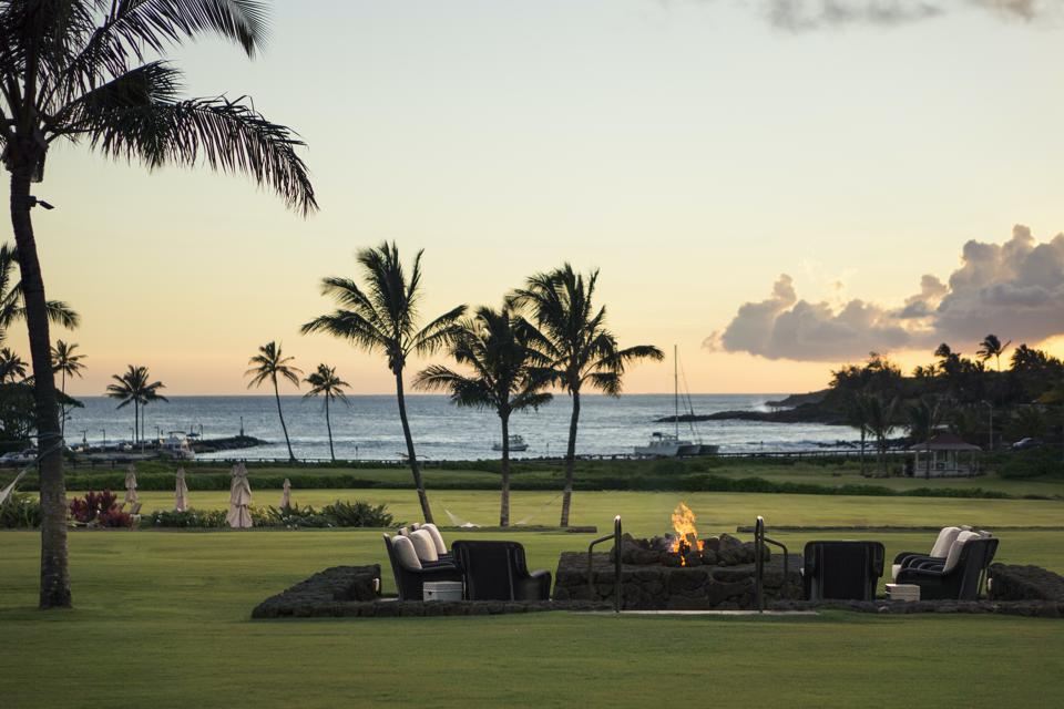 Kukui'ula member's parents, grandparents, children and grandchildren have full access to the club's facilities. The Firepit and Spouting Horn view from Plantation House is seen here.