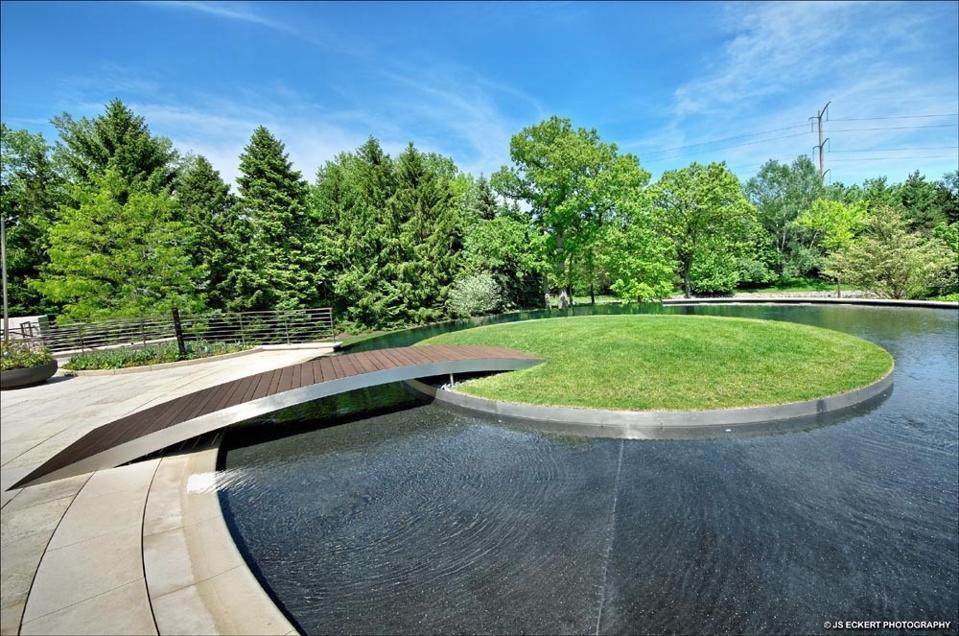 Circular infinity pool, grass island