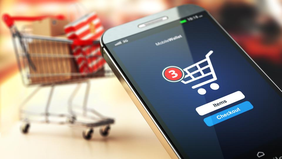 Online shopping concept nackground. Mobile phone or smartphone with cart and boxes and bag.