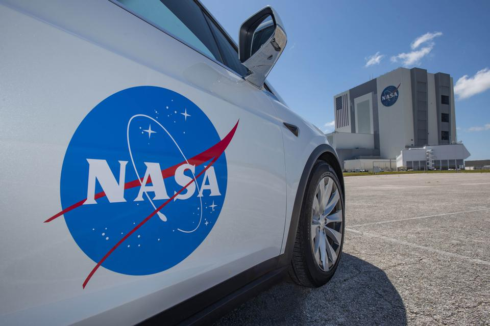 The astronauts will get to Pad 39A in a Tesla Model X.