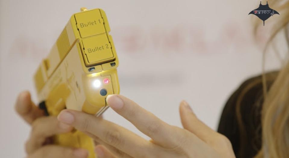 A yellow plastic nonlethal handgun