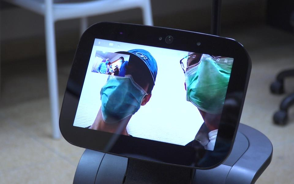Special robots in hospital with 2 doctors watching from a screen