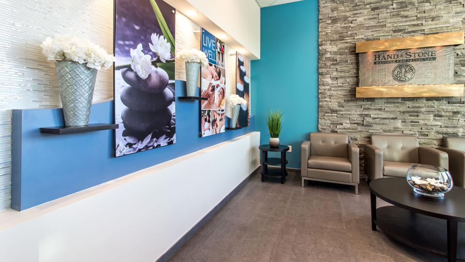 A waiting area of a Hand & Stone spa.