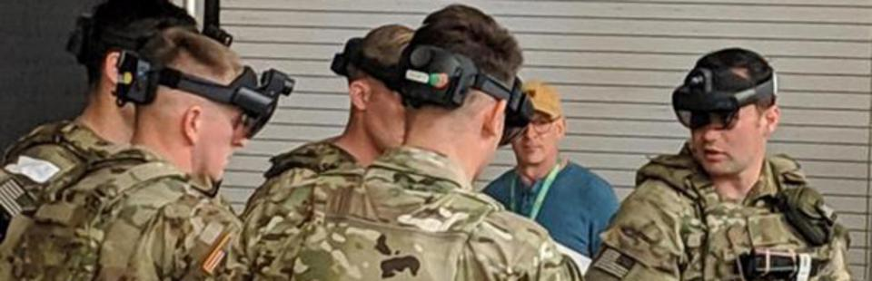 Soldiers wearing augmented reality goggles