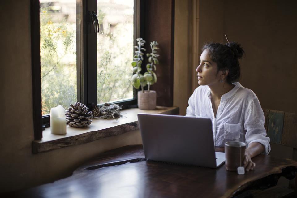 Mixed-race Young Adult Woman Works at Home Using Laptop Computer