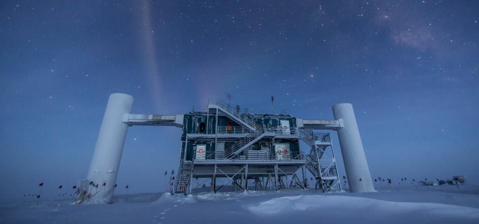 The IceCube Laboratory at the Amundsen-Scott South Pole Station, in Antarctica, hosts the computers collecting raw data. Due to satellite bandwidth allocations, the first level of reconstruction and event filtering happens in near real time in this lab. Only events selected as interesting for physics studies are sent to UW–Madison, where they are prepared for used by any member of the IceCube Collaboration.