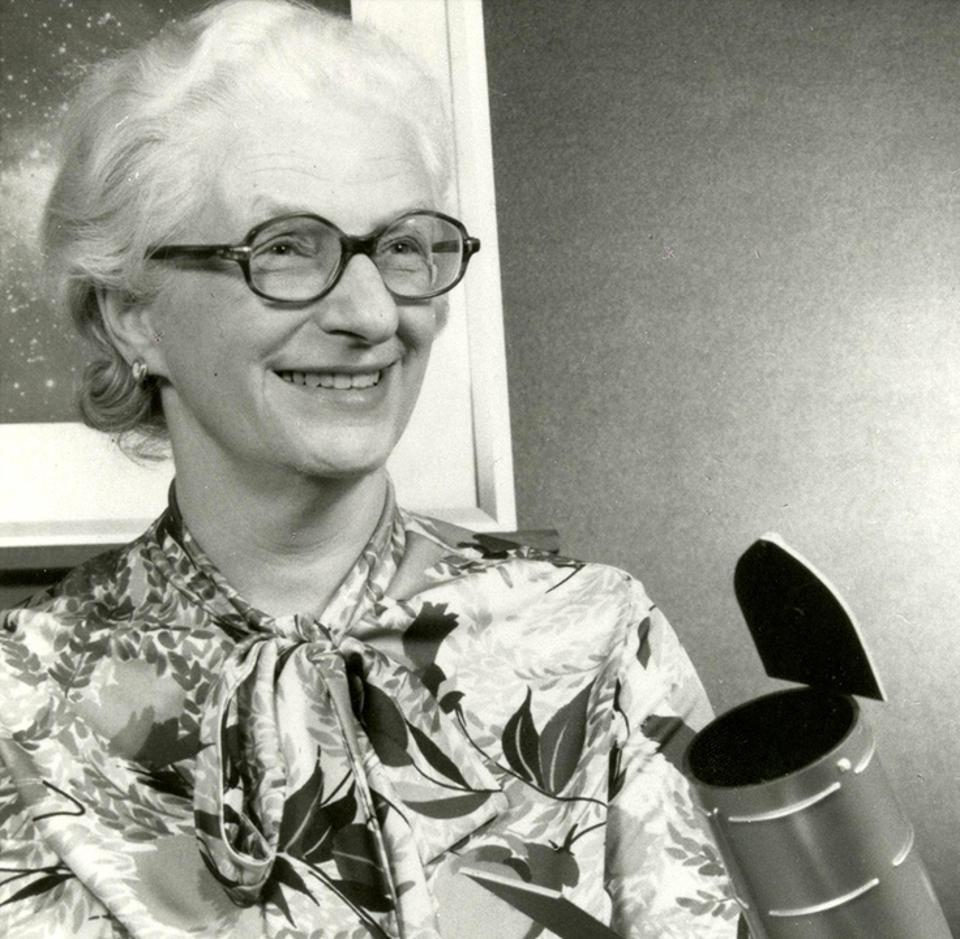 Dr. Nancy Grace Roman, NASA's first chief of astronomy, poses in 1966 with a model of what would become the Hubble Space Telescope.