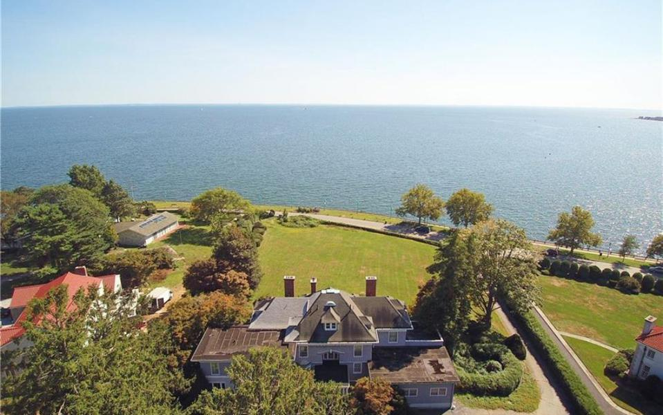 A Bridgeport, Ct. 1914 Georgian-style house with 7,429 square feet on 1.76 acres overlooking Long Island Sound. Asking Price: $875,000. Taxes: $71,848.