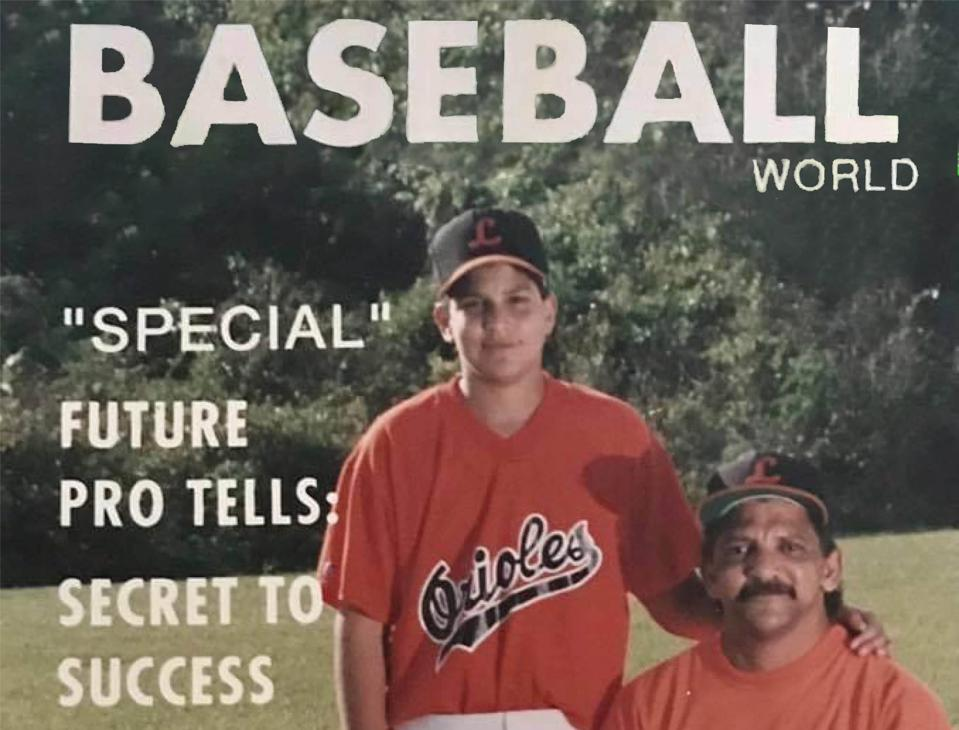 man and his son in a baseball game