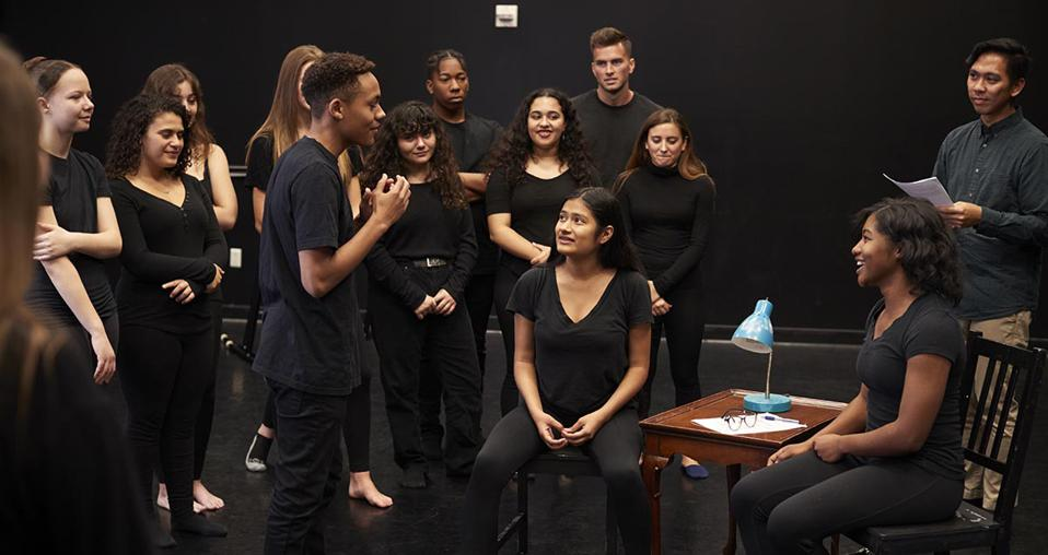 Students learning in an improvisation class