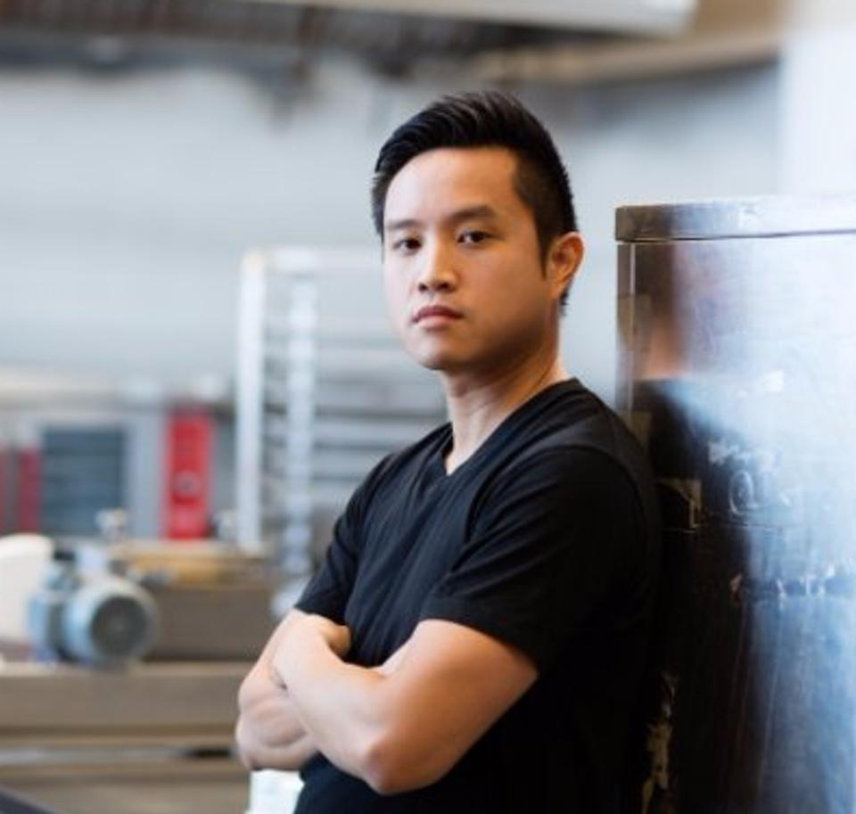 Collin Lam standing with arms crossed