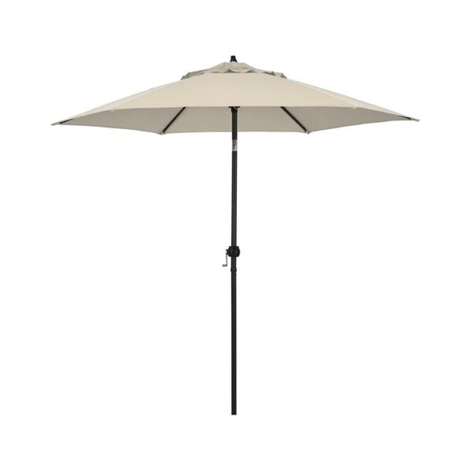 A beige canopy patio umbrella