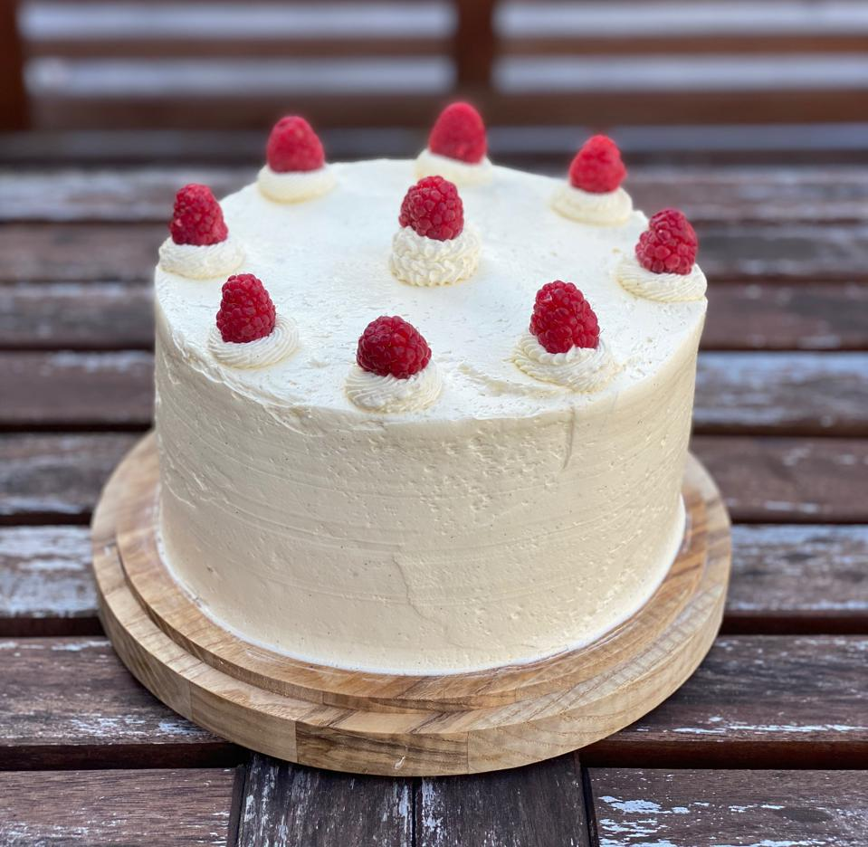 One of the new cakes Greg Rales is working on from home; lemon-scented white cake with lemon curd, raspberry jam and lemon-vanilla Italian buttercream