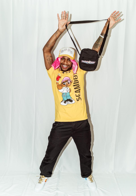 Rapper Guapdad 4000 wearing his merchandise.