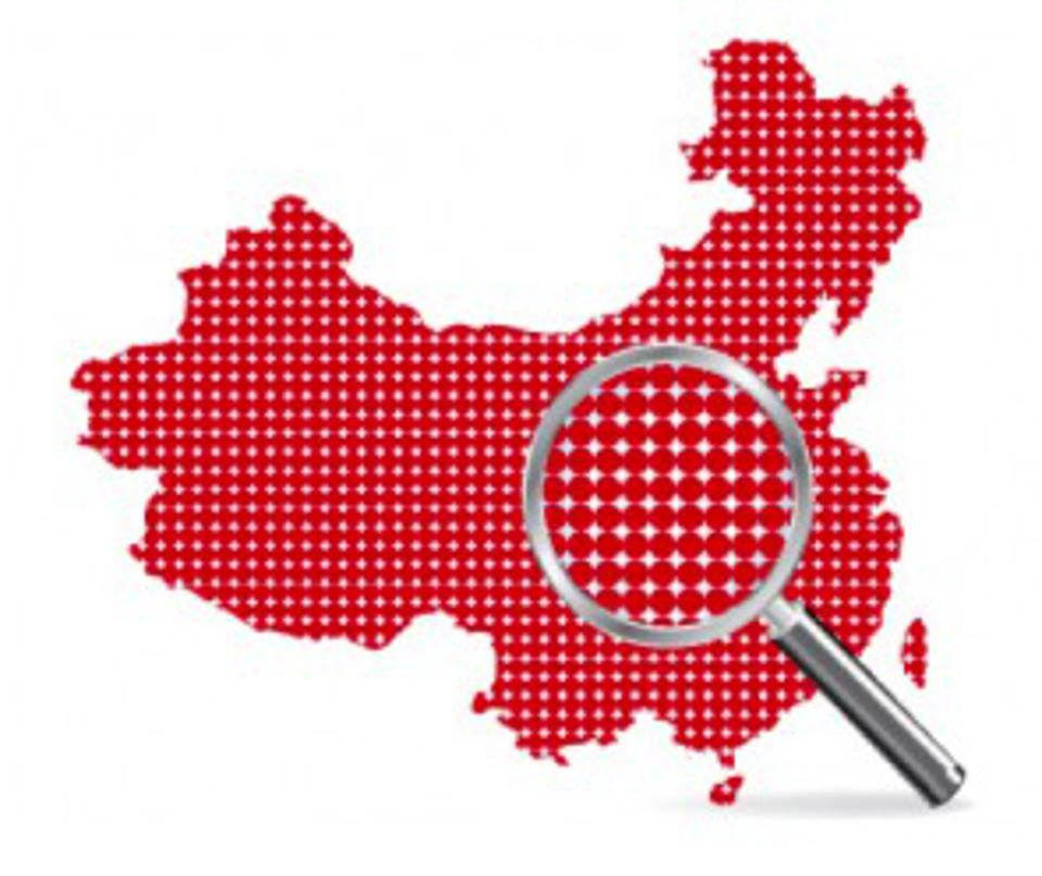 Map of China with focused magnifying glass.