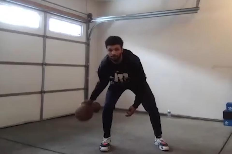 Denver Nuggets guard Jamal Murray practices a dribbling drill in a Jr. NBA at Home video