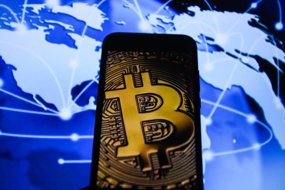 Bitcoin is seen on an android mobile phone...