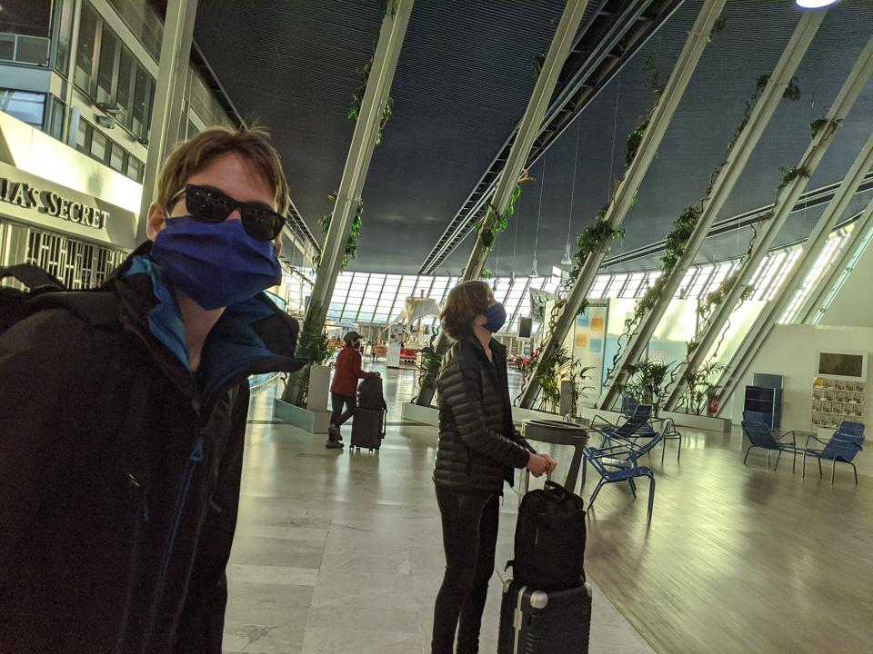The author's kids at the start of their journey in the almost abandoned airport in Nice, France.