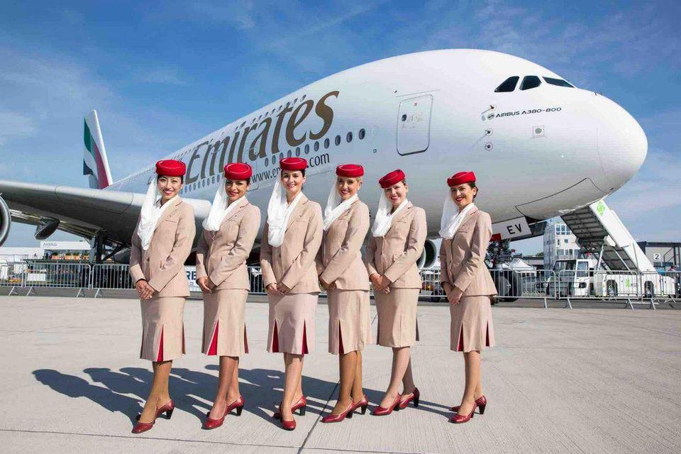 Emirates cabin crew with an A380