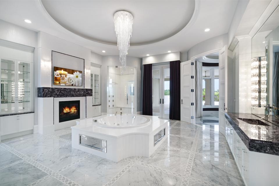 Amethyst-adorned master bathroom, crystal chandelier, fireplace