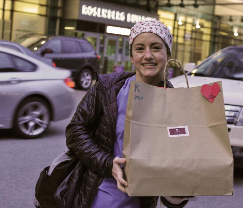 Frontline worker picks up meal from Front Line Family Meals Boston.